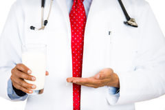 doctor showing the need for milk for healthy bones and growth and also to prevent osteoporosis Stock Photography