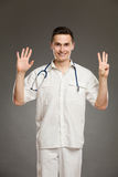 Doctor showing number eight Stock Image