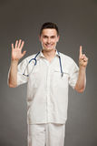 Doctor showing number six Stock Photography