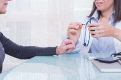 Doctor showing patient diabetes test strips Stock Photography
