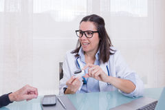 Doctor showing patient new medical device Stock Image