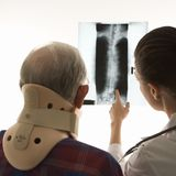 Doctor showing patient x-ray. Stock Images