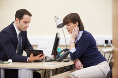 Doctor Showing Patient Test Results On Digital Tablet Royalty Free Stock Images