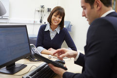 Doctor Showing Patient Test Results On Digital Tablet Royalty Free Stock Image