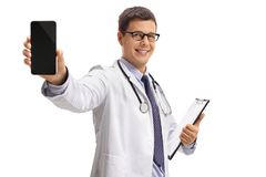 Doctor showing a phone and smiling Royalty Free Stock Photos