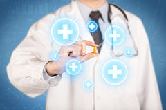 A doctor showing a pill with crosses Stock Image