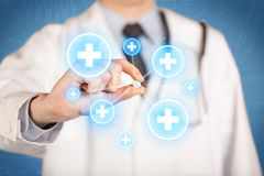 A doctor showing a pill with crosses Stock Photo