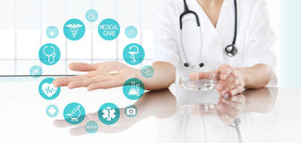 Doctor showing pill medicine with icons. Health care and medical. Concept Stock Image