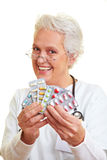 Doctor showing pills royalty free stock photography