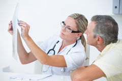 Doctor showing X rays to her patient Royalty Free Stock Image