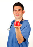 Doctor showing a red apple Stock Photo