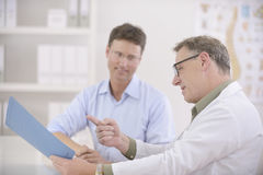Doctor showing results to  patient Stock Images
