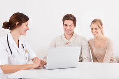Doctor showing results to patients Stock Photography