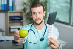Doctor showing right choice. Doctor showing the right choice Royalty Free Stock Images