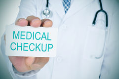 Doctor showing a signboard with the text medical checkup Stock Photography