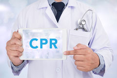 Doctor showing a small white sign CPR Stock Photography