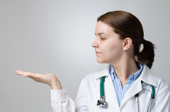 Doctor showing something on her palm Royalty Free Stock Images