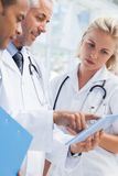 Doctor showing something in his tablet Stock Photo