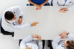 Doctor showing something imaginary on table Stock Images