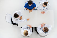 Doctor showing something imaginary on table Royalty Free Stock Image