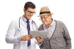 Doctor showing something on a tablet to a mature man Royalty Free Stock Photography