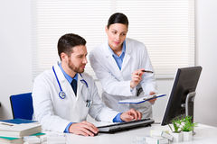 Doctor showing something to colleague Stock Photography