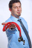 Doctor showing a stethoscope stock images