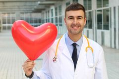 Doctor showing a strong healthy heart royalty free stock photography