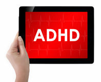 Doctor showing tablet with ADHD text. Stock Photos