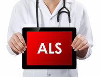 Doctor showing tablet with ALS text. Stock Image