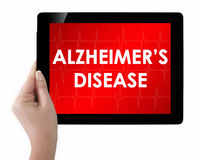Doctor showing tablet with ALZHEIMERS DISEASE text. Stock Photo