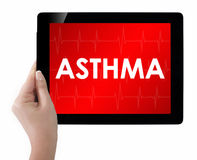 Doctor showing tablet with ASTHMA text. Royalty Free Stock Image