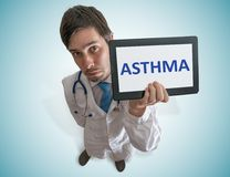 Doctor is showing tablet with Asthma written. View from top Stock Images