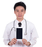 Doctor showing tablet computer blank screen Royalty Free Stock Photos