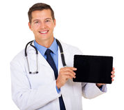 Doctor showing tablet computer Stock Image