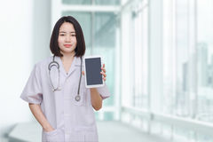 Doctor Showing Tablet Computer In Hospital Royalty Free Stock Images