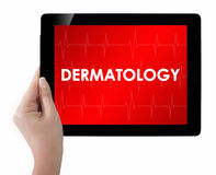 Doctor showing tablet with DERMATOLOGY text. Isolated on white Stock Photos