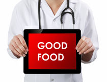 Doctor showing tablet with GOOD FOOD text. Stock Photography