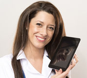 Doctor is showing a tablet. Doctor hold tablet next to head Stock Photos