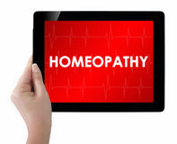 Doctor showing tablet with HOMEOPATHY text. Royalty Free Stock Image