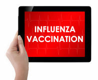 Doctor showing tablet with INFLUENZA VACCINATION text. Stock Images