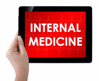 Doctor showing tablet with INTERNAL MEDICINE text. Royalty Free Stock Image