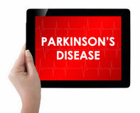 Doctor showing tablet with PARKINSONS DISEASE text. Royalty Free Stock Images
