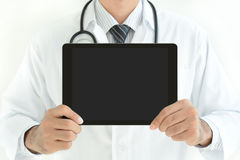Doctor showing tablet pc with empty screen Stock Photo