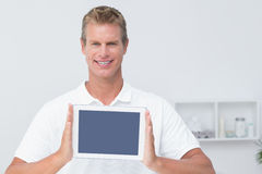 Doctor showing  tablet pc. In medical office Royalty Free Stock Photo