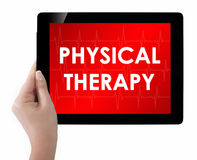 Doctor showing tablet with PHYSICAL THERAPY text. Isolated on white Stock Photos