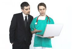 Doctor showing test results to a patient Stock Image