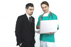 Doctor showing test results to a patient Royalty Free Stock Image