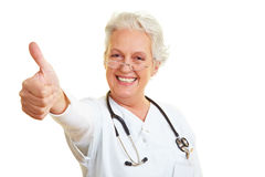 Doctor showing thumb up stock photos