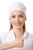 Doctor showing thumbs up gesture, isolated Stock Photography